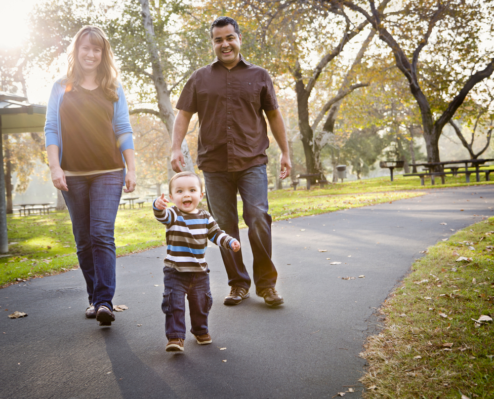 Couple and toddler walking on path
