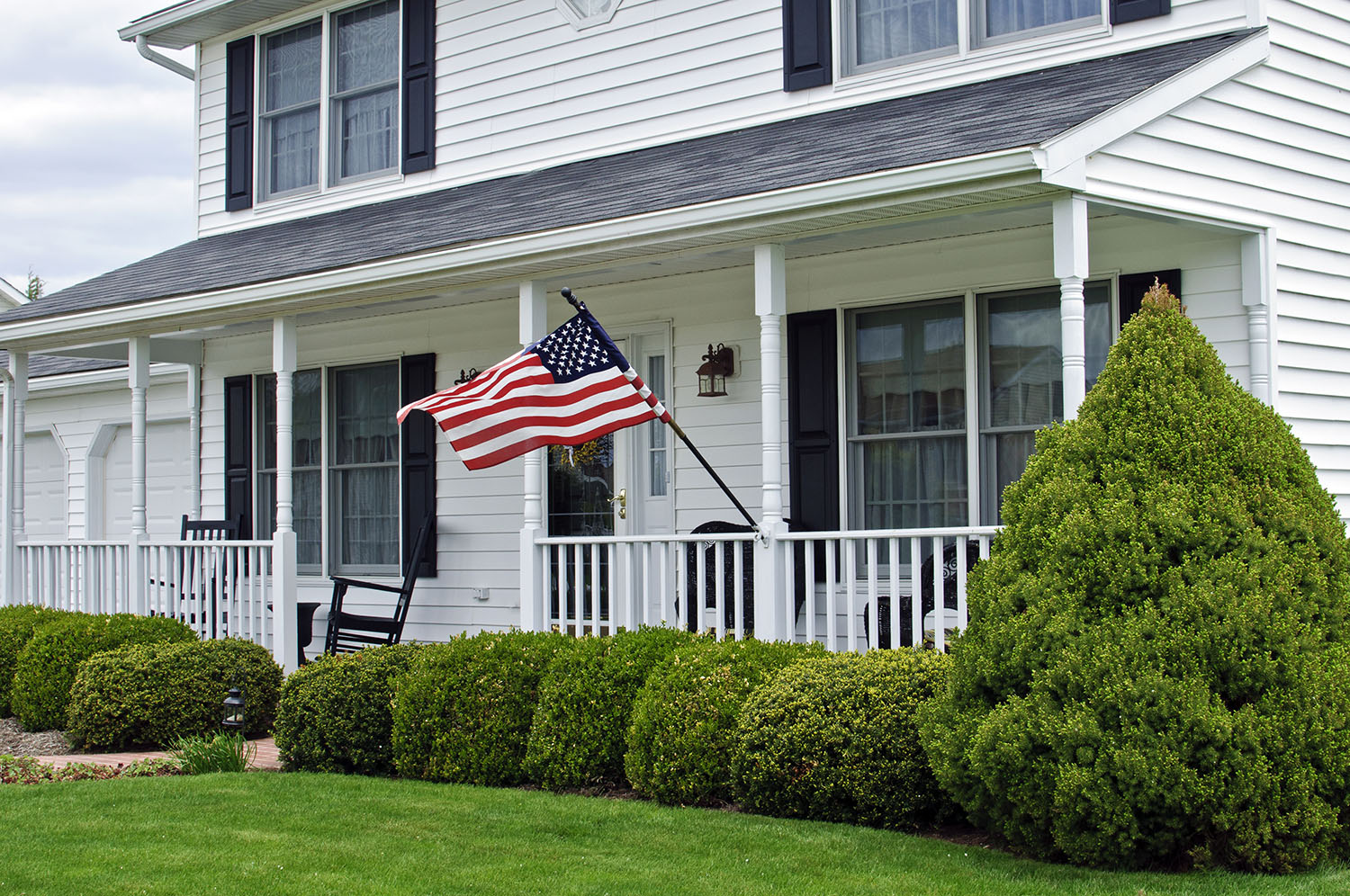 American Flag flying in front of house
